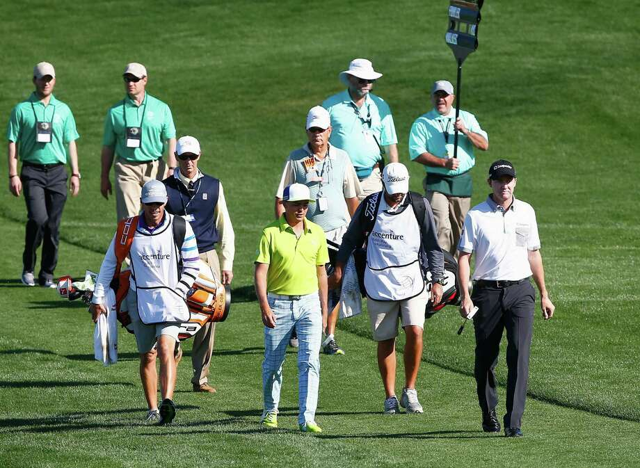 Rickie Fowler (second from left) and Boerne resident Jimmy Walker (right) walk to the No. 2 green at the Match Play Championships. Fowler beat Walker 1 up to advance to the round of 16. Photo: Sam Greenwood / Getty Images / 2014 Getty Images