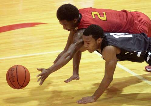 Yates guard Damion Lewis and Huffman guard Darion Gray dive for a loose ball during the first half of a high school basketball game on Thursday, Feb. 20, 2014, in Houston  . Photo: J. Patric Schneider, For The Chronicle / © 2014 Houston Chronicle