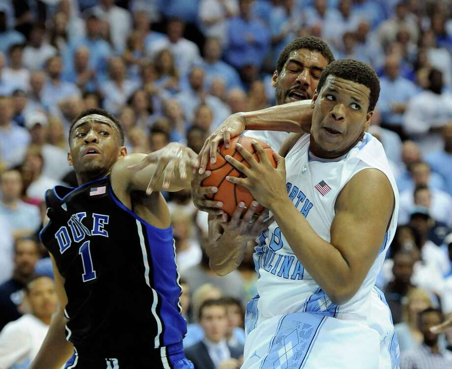 Duke's Jabari Parker (1) tussles with North Carolina's James Michael McAdoo, rear, and Kennedy Meeks for control of a rebound during Thursday's game. Photo: Grant Halverson, Stringer / 2014 Getty Images