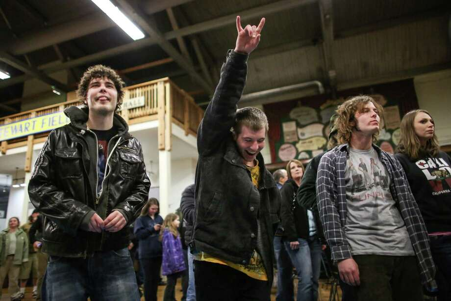 From left, Jake Jones, Garrett Gideon and Ty Gideon rock out to the sounds of the band Gebular in the Aberdeen Museum of History. Photo: JOSHUA TRUJILLO, SEATTLEPI.COM / SEATTLEPI.COM