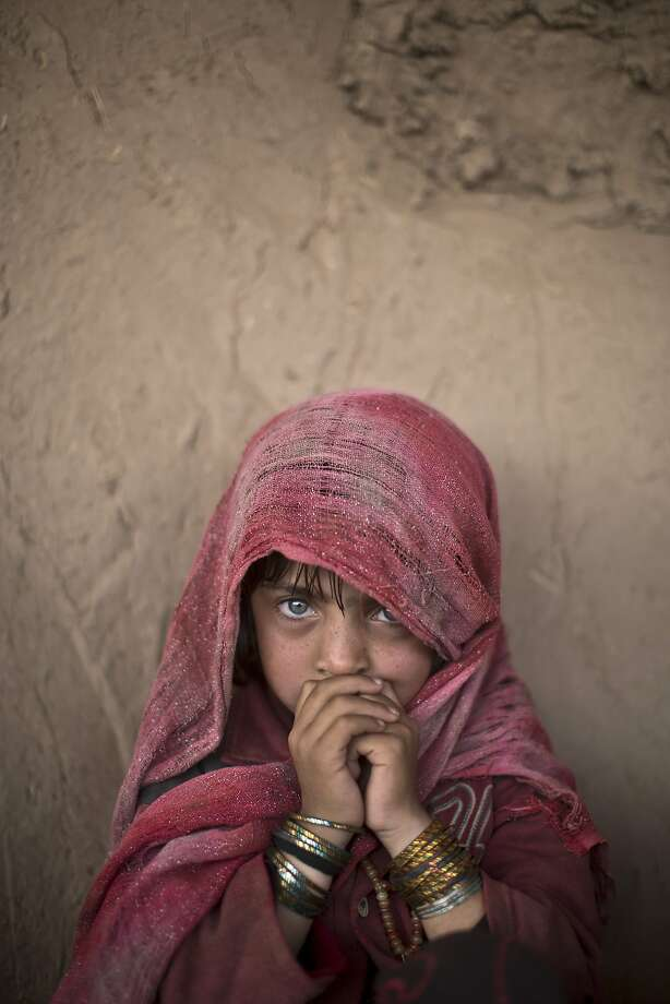"An Afghan refugee, Hamagai Akbar, 5, attends an event on the occasion of U.N. World Day Of Social Justice, at a makeshift school set up in a mosque on the outskirts of Islamabad, Pakistan, Thursday, Feb. 20, 2014. According to the U.N. website, the occasion aims to support efforts for ""poverty eradication, the promotion of full employment and decent work, gender equity and access to social well-being and justice for all."" (AP Photo/Muhammed Muheisen) Photo: Muhammed Muheisen, Associated Press"