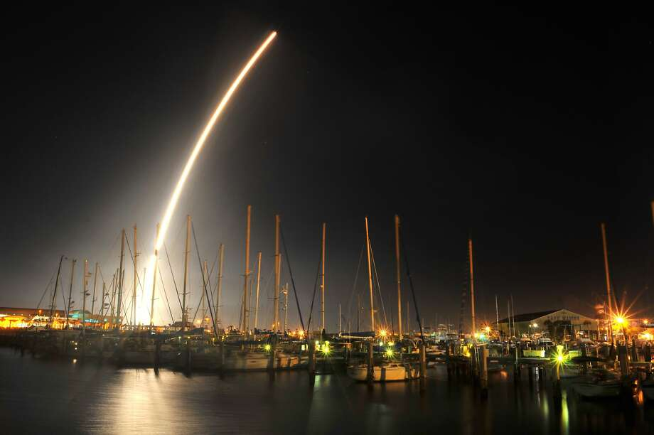 A ULA Delta IV rocket carrying a GPS satellite launches from Cape Canaveral Air Force Station Thursday, Feb. 20, 2014,  from Launch Complex 37. 46 second exposure photographed over the boats moored at the Ocean Club in Port Canaveral.  (AP/Florida Today, Malcolm Denemark) Photo: Malcolm Denemark/, Associated Press