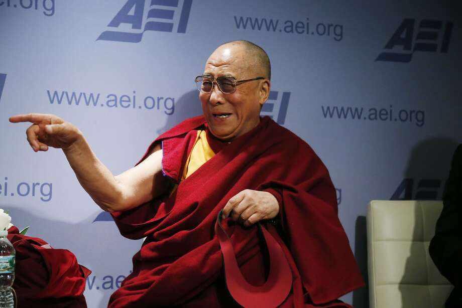 "Tibetan spiritual leader the Dalai Lama speaks at an event titled ""Happiness, Free Enterprise, and Human Flourishing"" at the American Enterprise Institute in Washington, Thursday, Feb. 20, 2014. (AP Photo/Charles Dharapak) Photo: Charles Dharapak, Associated Press"