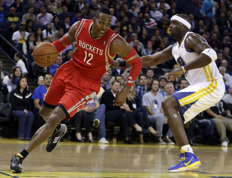 Feb. 20: Warriors 102, Rockets 99 (OT)Dwight Howard (12) drives around Jermaine O'Neal. Photo: Ben Margot, Associated Press