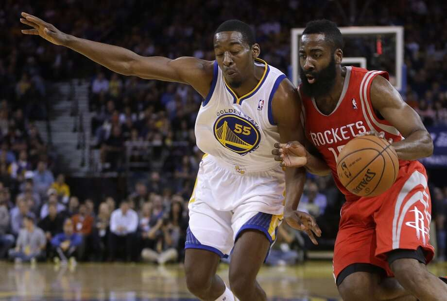 James Harden, right, drives against Jordan Crawford. Photo: Ben Margot, Associated Press