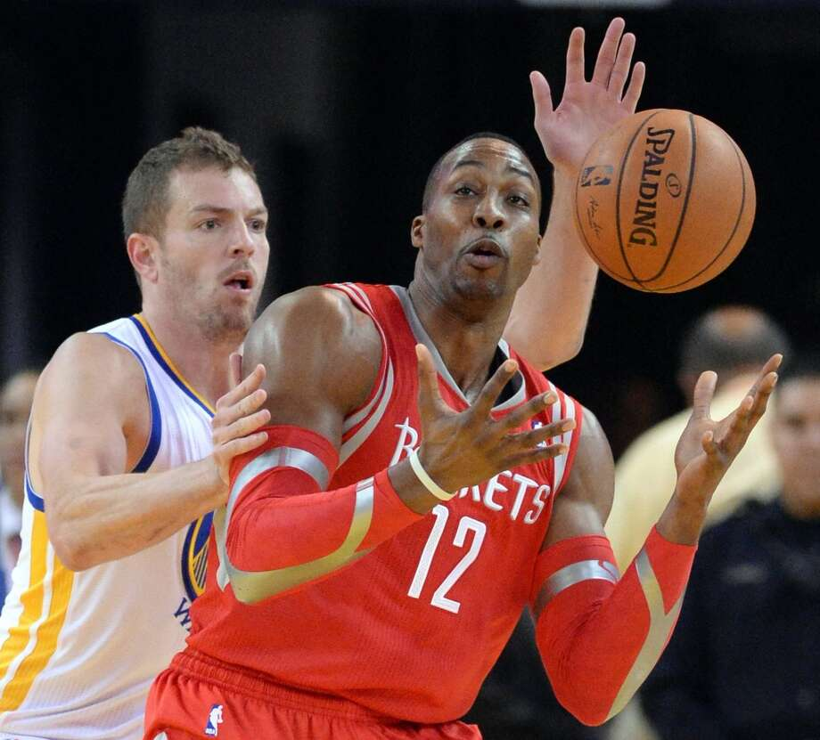 David Lee pressures Dwight Howard. Photo: Doug Duran, McClatchy-Tribune News Service