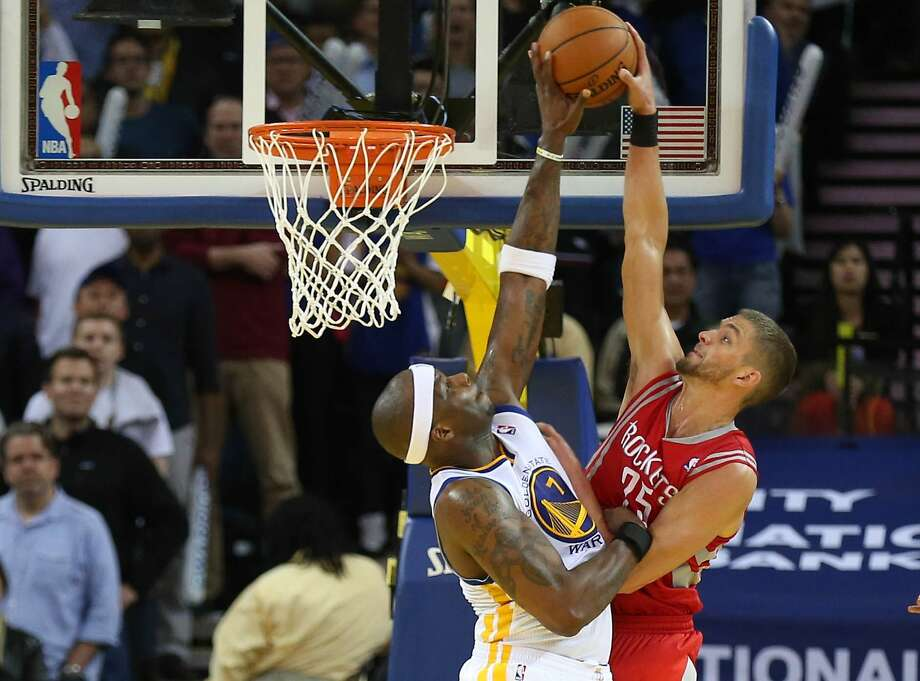 Feb 20, 2014; Oakland, CA, USA; Golden State Warriors center Jermaine O'Neal (7) blocks Houston Rockets small forward Chandler Parsons (25) during the overtime period at Oracle Arena. The Golden State Warriors defeated the Houston Rockets 102-99 in overtime. Mandatory Credit: Kelley L Cox-USA TODAY Sports Photo: Kelley L Cox, Reuters