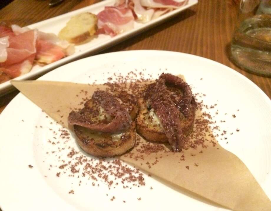 Crostini with truffle butter, anchovy and chocolate at La Nebbia