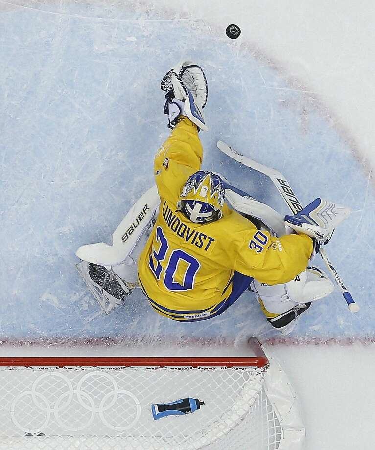 Sweden goaltender Henrik Lundqvist makes a save during a men's semifinal ice hockey game against Finland at the 2014 Winter Olympics, Friday, Feb. 21, 2014, in Sochi, Russia.  Photo: David J. Phillip, Associated Press