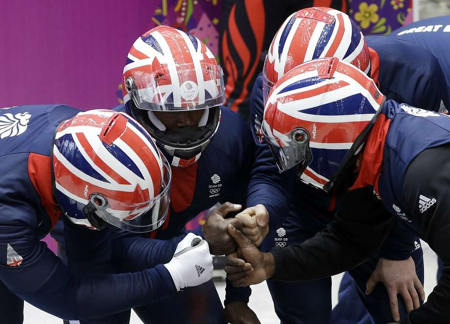 The team from Great Britain GBR-2, piloted by Lamin Deen, prepare to start a run during the men's four-man bobsled training at the 2014 Winter Olympics, Friday, Feb. 21, 2014, in Krasnaya Polyana, Russia.  Photo: Dita Alangkara, Associated Press