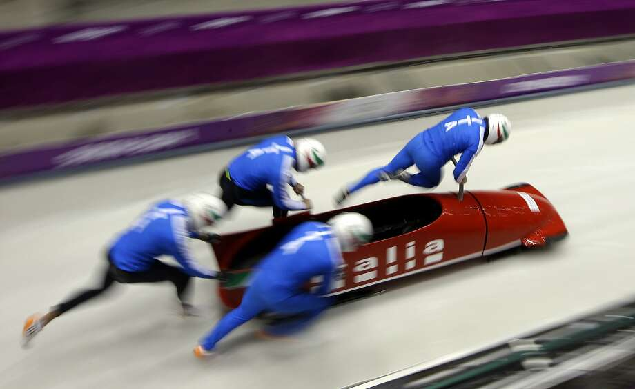 The team from Italy ITA-1, piloted by Simone Bertazzo, start a run during the men's four-man bobsled training at the 2014 Winter Olympics, Friday, Feb. 21, 2014, in Krasnaya Polyana, Russia. Photo: Dita Alangkara, Associated Press
