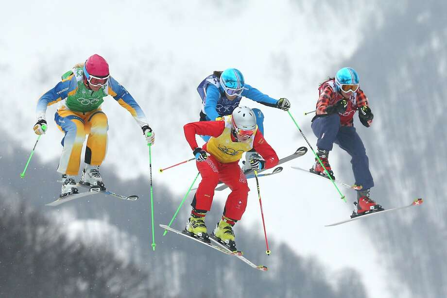 Anna Holmlund (L) of Sweden competes with Fanny Smith of Switzerland (yellow top), Katrin Ofner of Austria and Kelsey Serwa (R) of Canada in the Freestyle Skiing Womens' Ski Cross Semifinals on day 14 of the 2014 Winter Olympics at Rosa Khutor Extreme Park on February 21, 2014 in Sochi, Russia. Photo: Cameron Spencer, Getty Images