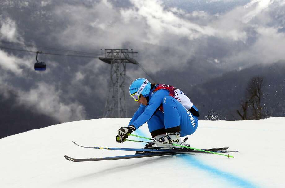 Austria's Katrin Ofner takes a jump during a women's ski cross seeding run at the Rosa Khutor Extreme Park, at the 2014 Winter Olympics, Friday, Feb. 21, 2014, in Krasnaya Polyana, Russia. Photo: Sergei Grits, Associated Press