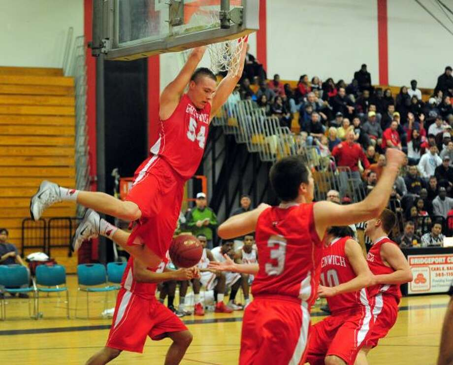 Alex Wolf of Greenwich finishes off against a dunk against Bridgeport Central
