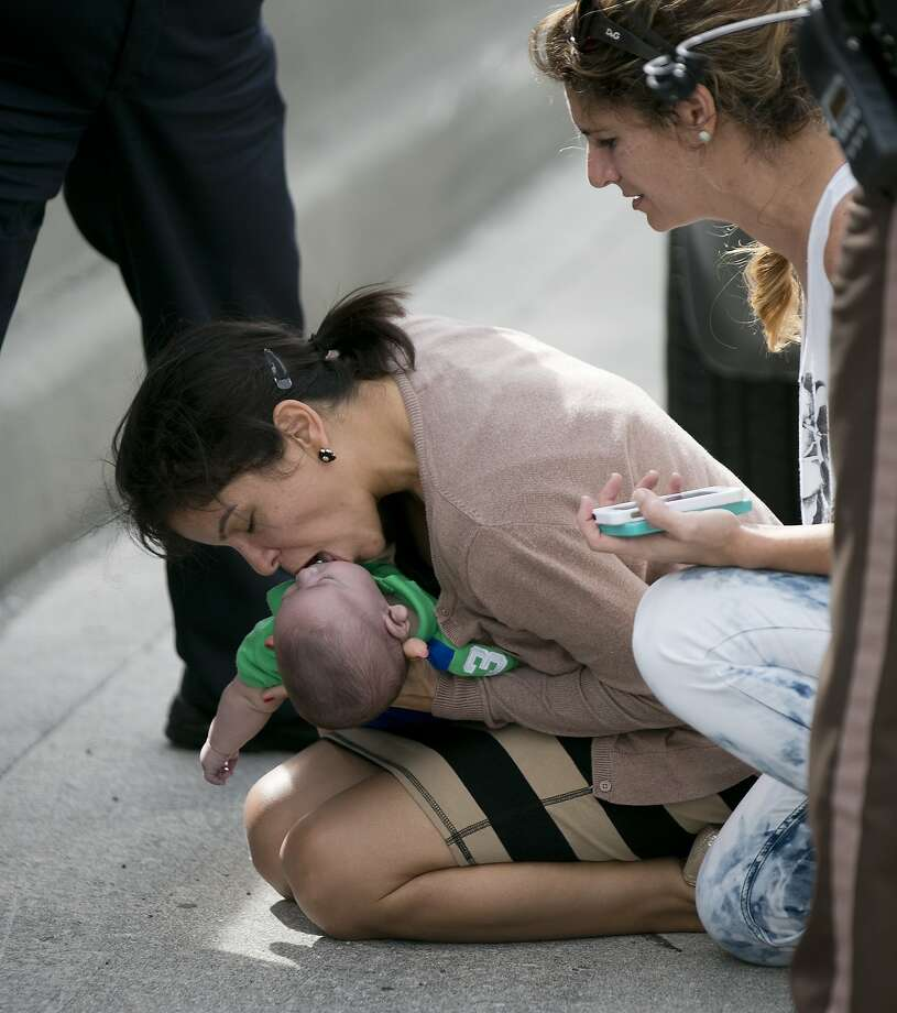 Close call in Miami: Pamela Rauseo performs CPR on her nephew, 5-month-old Sebastian de la Cruz, after pulling 