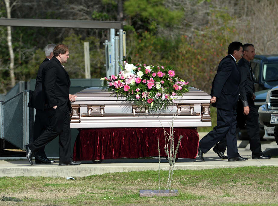 A casket is moved to one of the two hearses after Thursday's services Thursday.  Funeral services for Sterling, 15, and Burns were held Thursday afternoon at Crestwood Baptist Church in Lumberton. The sisters, as well as Burns' unborn child, were died after being involved in a car wreck on February 2. Photo taken Thursday, 2/20/14 Jake Daniels/@JakeD_in_SETX Photo: Jake Daniels / ©2013 The Beaumont Enterprise/Jake Daniels