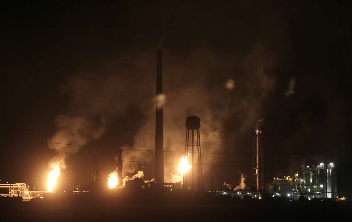 In a 2010 file photo, the Tesoro Golden Eagle refinery spews black smoke from it's smokestacks as they burn as a result of a power outage.