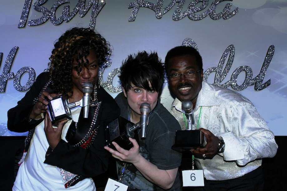 Bay Area Houston Idol crowned its 2014 winners on Feb. 18 before a packed crowd at Jackie's Brickhouse in Kemah. The winners, from left, are: Morena Roas, third; Ashley Hennessy, first, and James A. Williams Jr., second. Photo: Courtesy Bay Area Houston Idol