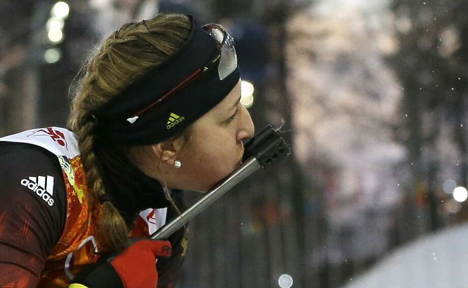 Germany's Franziska Preuss blows into the sight of her rifle during the women's biathlon 4x6k relay at the 2014 Winter Olympics, Friday, Feb. 21, 2014, in Krasnaya Polyana, Russia. (AP Photo/Kirsty Wigglesworth) Photo: Kirsty Wigglesworth, Associated Press