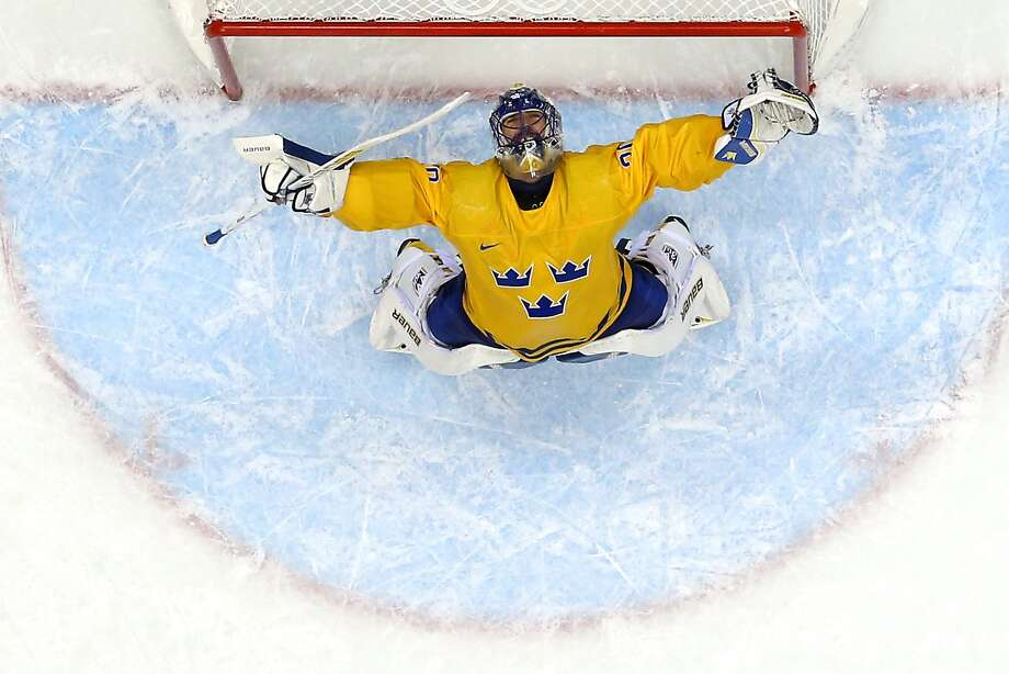 Henrik Lundqvist #30 of Sweden celebrates after defeating Finland 2-1 during the Men's Ice Hockey Semifinal Playoff on Day 14 of the 2014 Sochi Winter Olympics at Bolshoy Ice Dome on February 21, 2014 in Sochi, Russia. Photo: Martin Rose, Getty Images