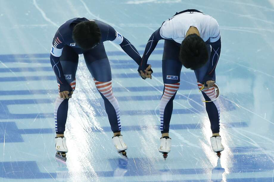 Speedskater from South Korea Kim Bo-reum, left, holds a teammate's hand after competing in the women's speedskating team pursuit quarterfinals at the Adler Arena Skating Center during the 2014 Winter Olympics in Sochi, Russia, Friday, Feb. 21, 2014.  Photo: Patrick Semansky, Associated Press