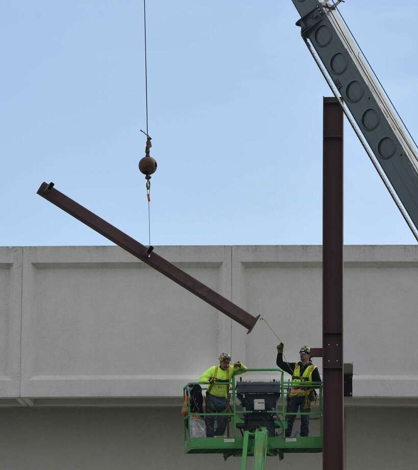 Workers install steel beams for the new facade of Whole Foods at the south end of Colonie Center Thursday afternoon, Feb. 20, 2014, in Colonie, N.Y.       (Skip Dickstein / Times Union) Photo: Skip Dickstein