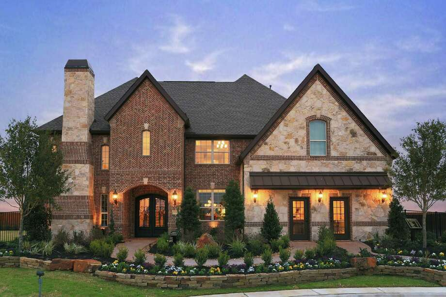 The new Maltese model (shown) showcases Toll Brothers' signature style, with a traditional exterior combining stone and detailed brick patterning, especially on the chimney.