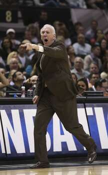 San Antonio Spurs head coach Gregg Popovich gets called for a technical foul after responding to a foul during the first half against the Oklahoma City Thunder at the AT&T Center, Wednesday, Jan. 22, 2014. Photo: Jerry Lara, San Antonio Express-News