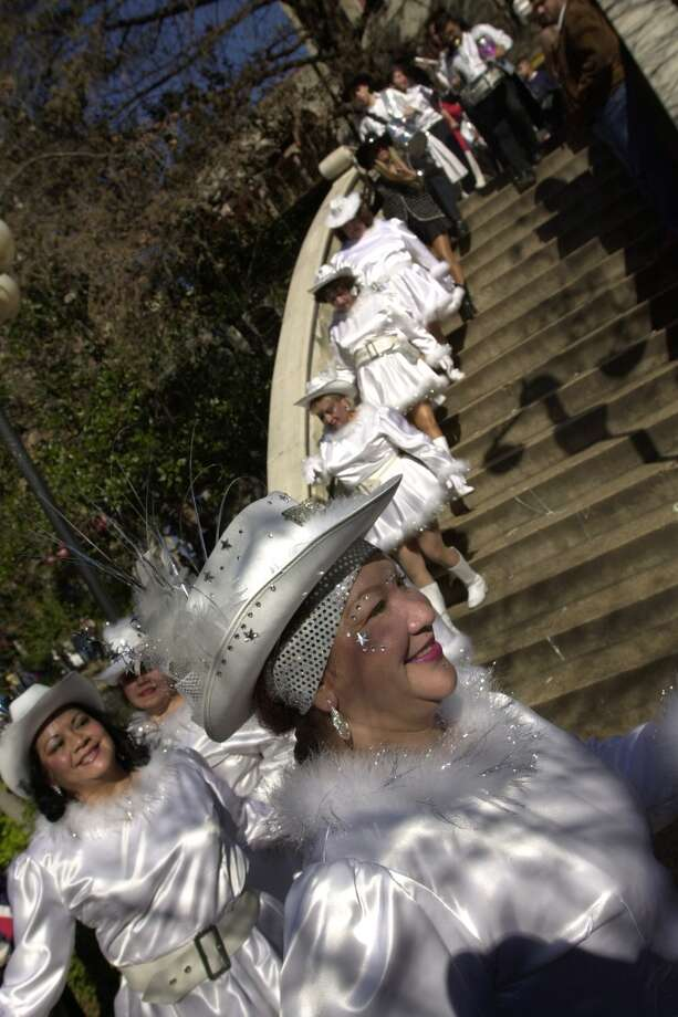 Diana DeLeon, 45, of the San Antonio Street Dance and Drum Company parade across the San Antonio River during the 2001 Miller Lite Mud Festival Sunday Morning along the Riverwalk in San Antonio.(San Antonio Express-News Photo By Maria J.Avila) Photo: EXPRESS-NEWS FILE PHOTO