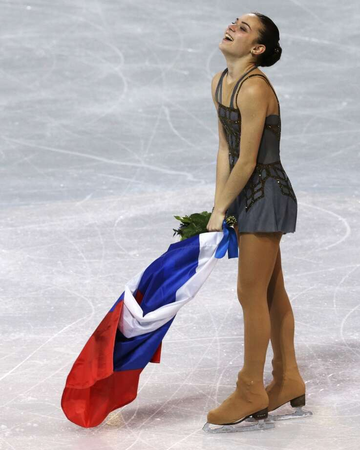 Adelina Sotnikova of Russia celebrates winning the women's free skate figure skating final at the Iceberg Skating Palace during the 2014 Winter Olympics, Thursday, Feb. 20, 2014, in Sochi, Russia. (AP Photo/Darron Cummings) Photo: Darron Cummings, Associated Press