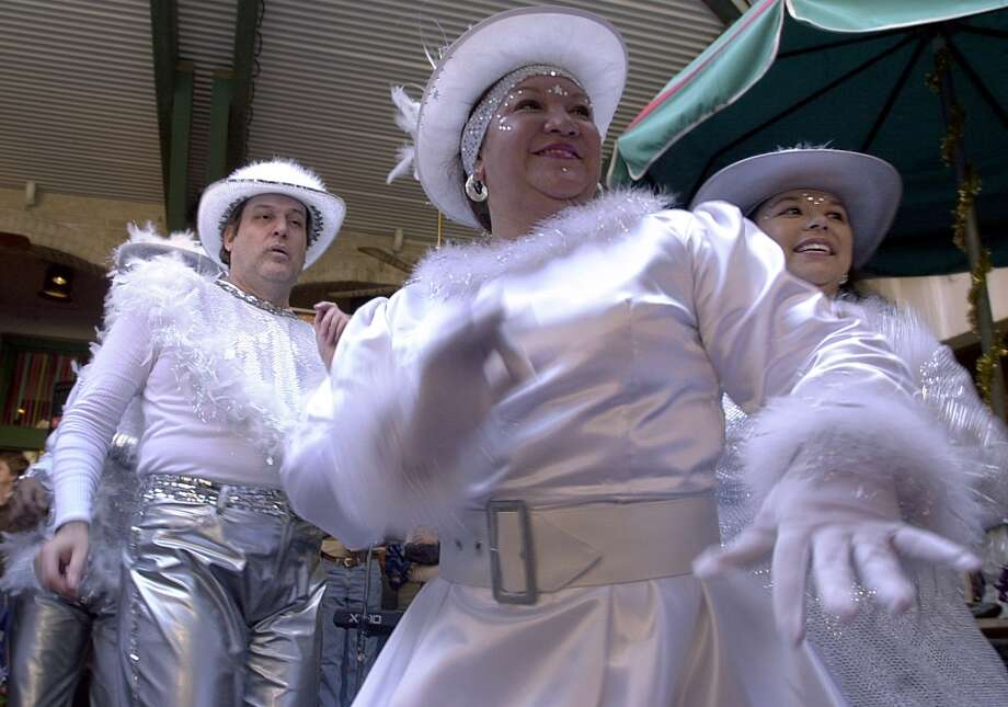 (front) Diana DeLeon, 45, (back) Rick Yanez, 46, Juanita Leal, 36, of the San Antonio Street Dance and Drum Company perform during the 2001 Miller Lite Mud Festival Sunday Morning along the Riverwalk in San Antonio.(San Antonio Express-News Photo By Maria J.Avila) Photo: EXPRESS-NEWS FILE PHOTO