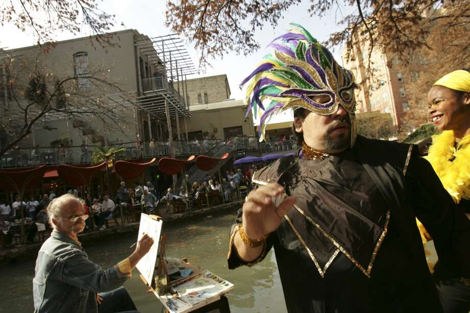Rick Torres and Lelia Benshoof, of the SA Street and Dance and Drum Company, dance along the Riverwalk as they participate in The XIX Annual Michelob Ultra River Walk Mud Parade on the River Walk in San Antonio on Sunday, January 15, 2006. Lisa Krantz/STAFF Photo: SAN ANTONIO EXPRESS-NEWS