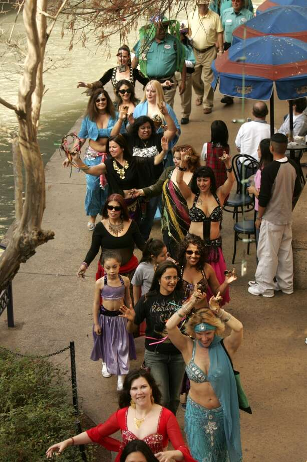 The XIX Annual Michelob Ultra River Walk Mud Parade, including the Karavan Sudio Belly Dance Troupe, makes its way along the River Walk in San Antonio on Sunday, January 15, 2006. Lisa Krantz/STAFF Photo: SAN ANTONIO EXPRESS-NEWS