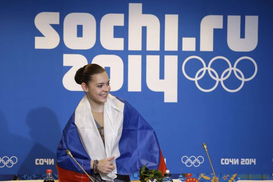 Adelina Sotnikova of Russia arrives for a news conference after she won the women's free skate figure skating finals at the Iceberg Skating Palace during the 2014 Winter Olympics, Thursday, Feb. 20, 2014, in Sochi, Russia. Sotnikova placed first, followed by Kim and Kostner. (AP Photo/Darron Cummings) Photo: Darron Cummings, Associated Press