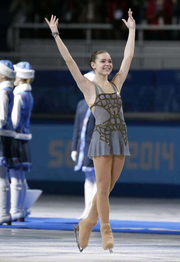 Adelina Sotnikova of Russia acknowledges the crowd during the flower ceremony after she won the women's free skate figure skating finals at the Iceberg Skating Palace during the 2014 Winter Olympics, Thursday, Feb. 20, 2014, in Sochi, Russia. (AP Photo/Bernat Armangue) Photo: Bernat Armangue, Associated Press