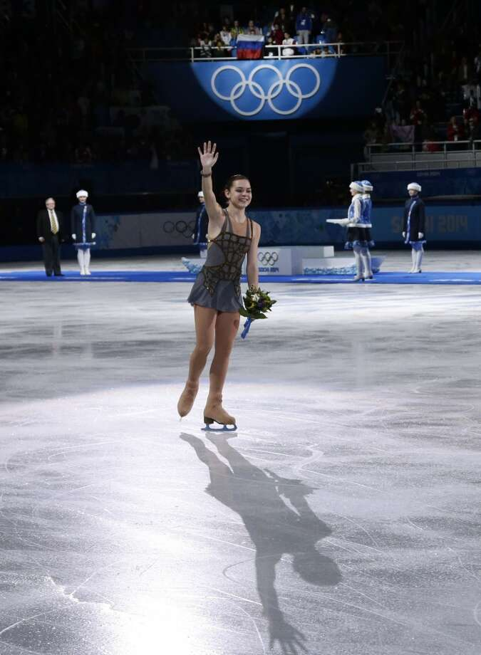 Adelina Sotnikova of Russia waves to spectators after placing first in the results area after completing her routine in the women's free skate figure skating finals at the Iceberg Skating Palace during the 2014 Winter Olympics, Thursday, Feb. 20, 2014, in Sochi, Russia. (AP Photo/Bernat Armangue) Photo: Bernat Armangue, Associated Press