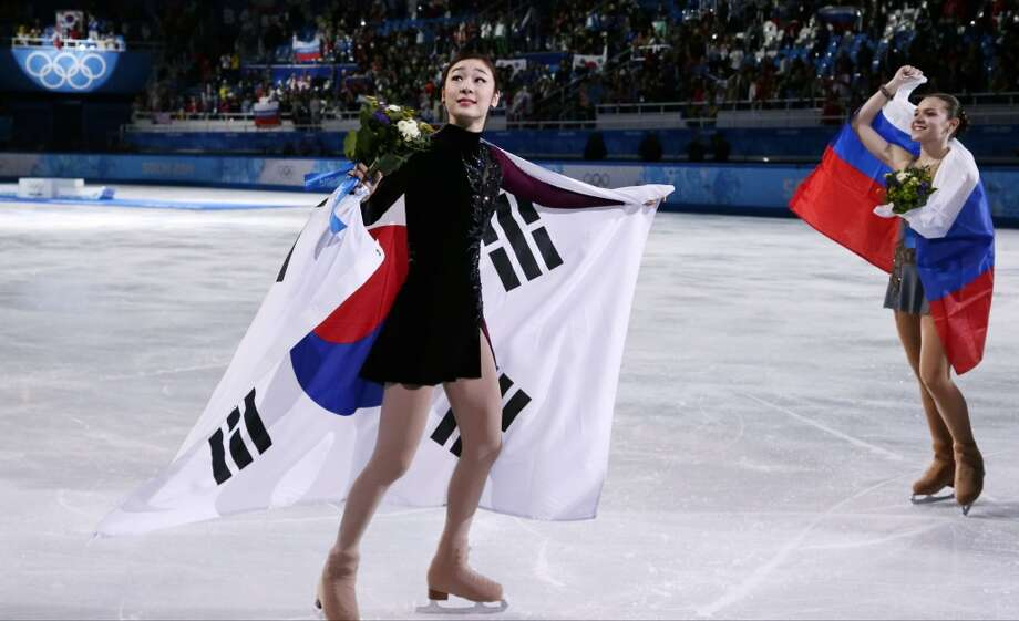Yuna Kim of South Korea, left, and Adelina Sotnikova of Russia skate on the ice following the flower ceremony for the women's free skate figure skating finals at the Iceberg Skating Palace during the 2014 Winter Olympics, Thursday, Feb. 20, 2014, in Sochi, Russia. Sotnikova placed first, followed by Kim and Kostner. (AP Photo/Bernat Armangue) Photo: Bernat Armangue, Associated Press
