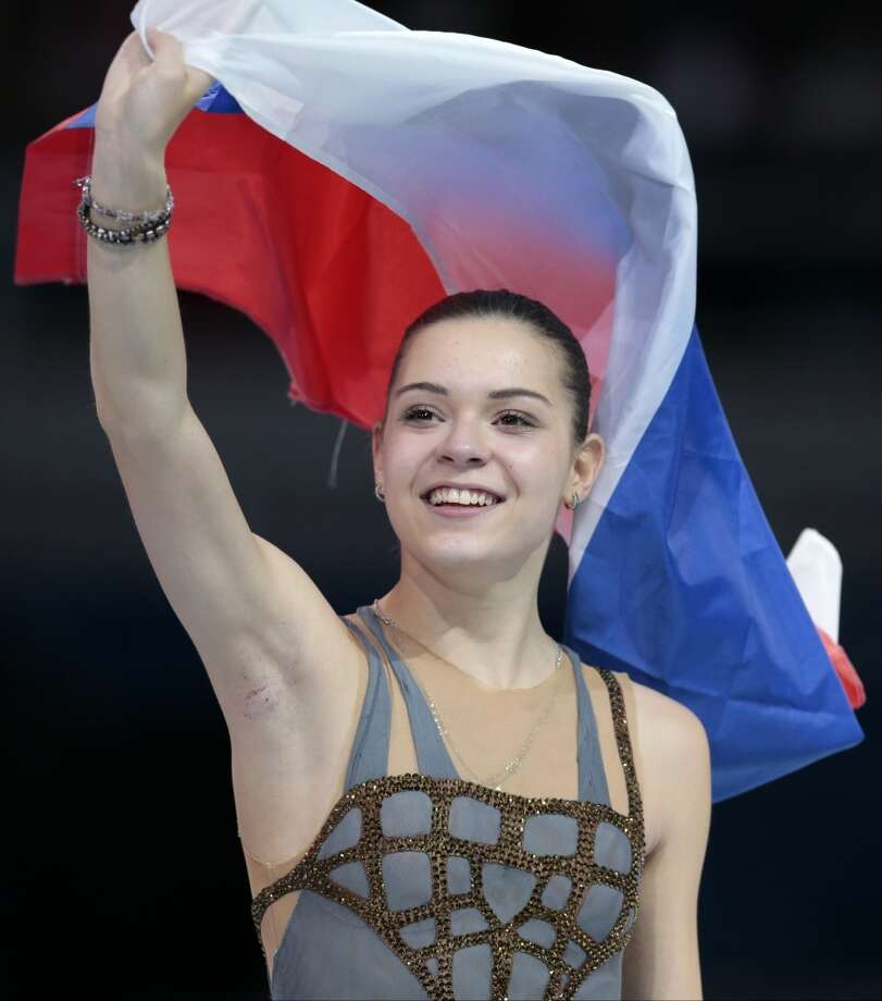 Adelina Sotnikova of Russia celebrates winning the women's free skate figure skating finals following the flower ceremony at the Iceberg Skating Palace during the 2014 Winter Olympics, Thursday, Feb. 20, 2014, in Sochi, Russia. (AP Photo/Ivan Sekretarev) Photo: Ivan Sekretarev, Associated Press