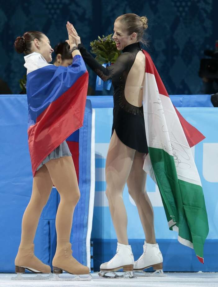 Adelina Sotnikova of Russia, left, and Carolina Kostner of Italy celebrate following the women's free skate figure skating finals at the Iceberg Skating Palace during the 2014 Winter Olympics, Thursday, Feb. 20, 2014, in Sochi, Russia. Sotnikova placed first, followed by Kim and Kostner.  (AP Photo/Ivan Sekretarev) Photo: Ivan Sekretarev, Associated Press