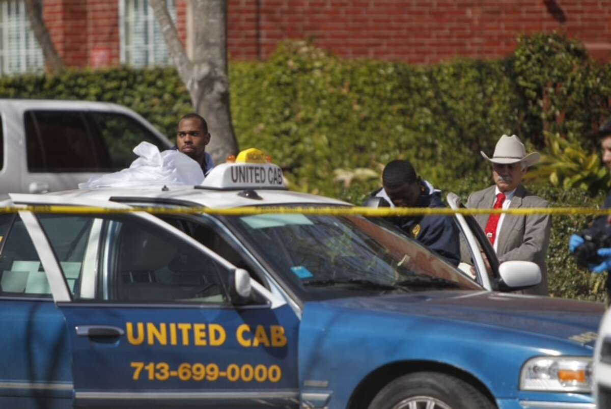 United Cab driver has been found dead in southwest Houston near apartment complex, Friday, Feb. 21, 2014. Houston police investigators talking to witnesses said that they heard shots around 11 pm last night. (Cody Duty / Houston Chronicle)