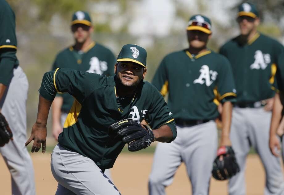 A's pitcher Raul Alcantara, (70) chases down a come backer to the mound during drills at the Papago Baseball Facility in Phoenix, Arizona on Thursday Feb. 20, 2014. The Oakland Athletics continue their spring training schedule in the Arizona desert in preparation of the 2014 MBL season. Photo: The Chronicle