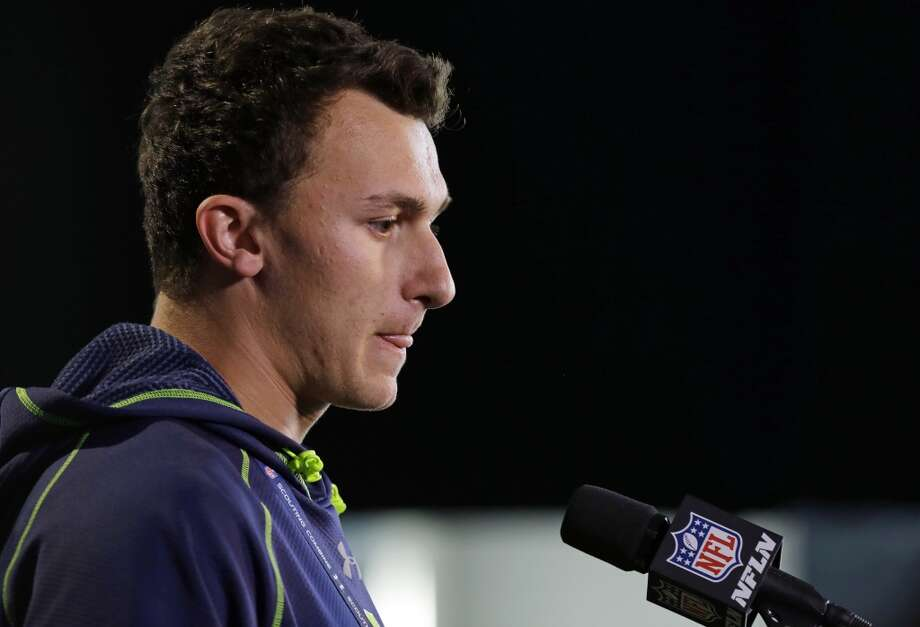 Former Texas A&M quarterback Johnny Manziel speaks to the media at the NFL combine. Photo: Michael Conroy, Associated Press