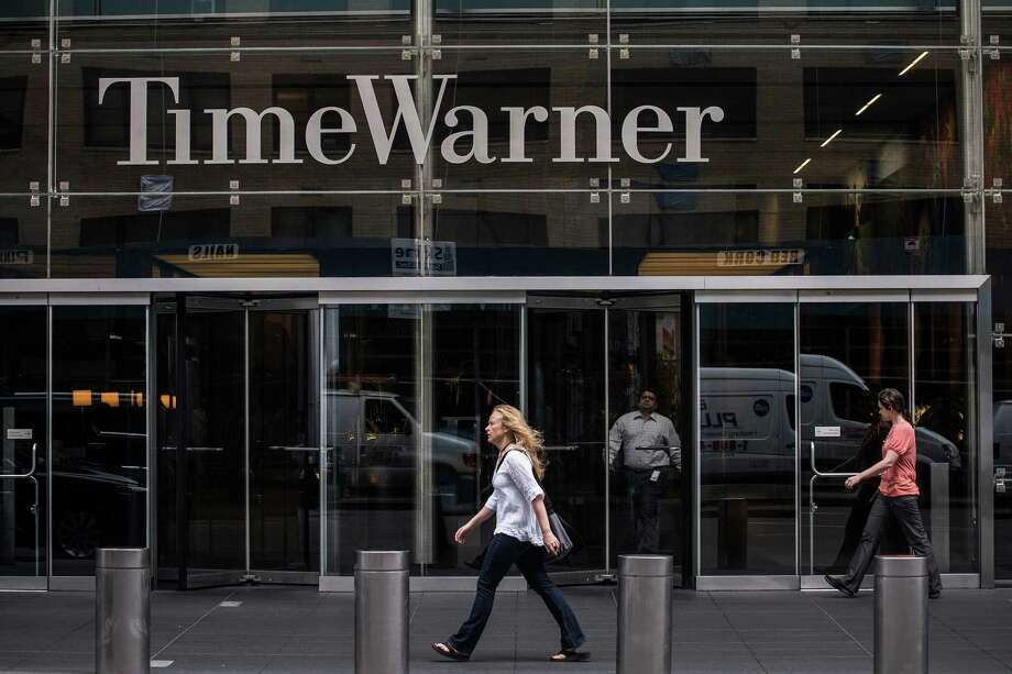 AOL purchased Time Warner in 2000 for more than $160 billion, creating what was lauded as a media giant for the new millennium. It is now viewed as one of the worst mergers in history. Their relationship ended in 2009. In February 2014, Comcast struck a deal to buy Time Warner for $45.2 billion in stock. Photo: Andrew Burton, Images / 2013 Getty Images