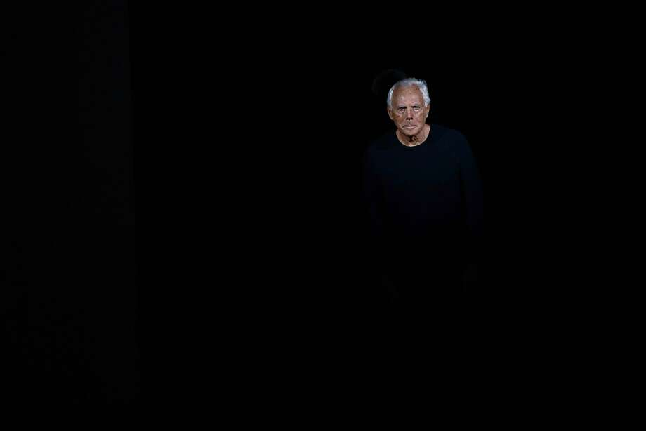 Talking head: A disembodied Giorgio Armani acknowledges his audience at the Emporio Armani show during Women's Fashion Week in Milan. Photo: Giuseppe Cacace, AFP/Getty Images