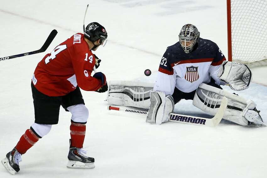 USA goaltender Jonathan Quick blocks Canada forward Chris Kunitz's shot on the goal during the third period of a men's semifinal ice hockey game at the 2014 Winter Olympics, Friday, Feb. 21, 2014, in Sochi, Russia.