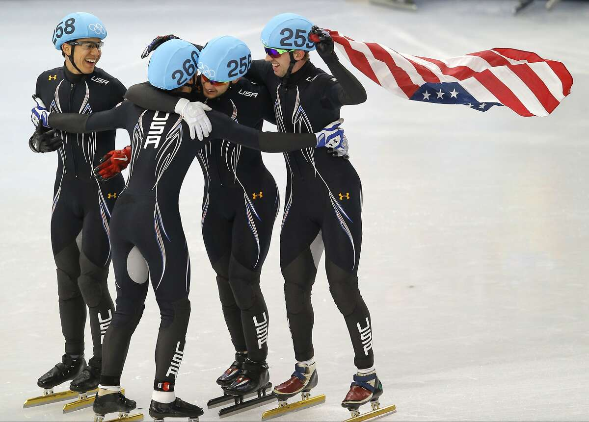 From left, J.R. Celski of the United States, Jordan Malone of the United States, Eduardo Alvarez of the United States and Chris Creveling of the United States celebrate their second place finish in the men's 5000m short track speedskating relay final at the Iceberg Skating Palace during the 2014 Winter Olympics, Friday, Feb. 21, 2014, in Sochi, Russia.