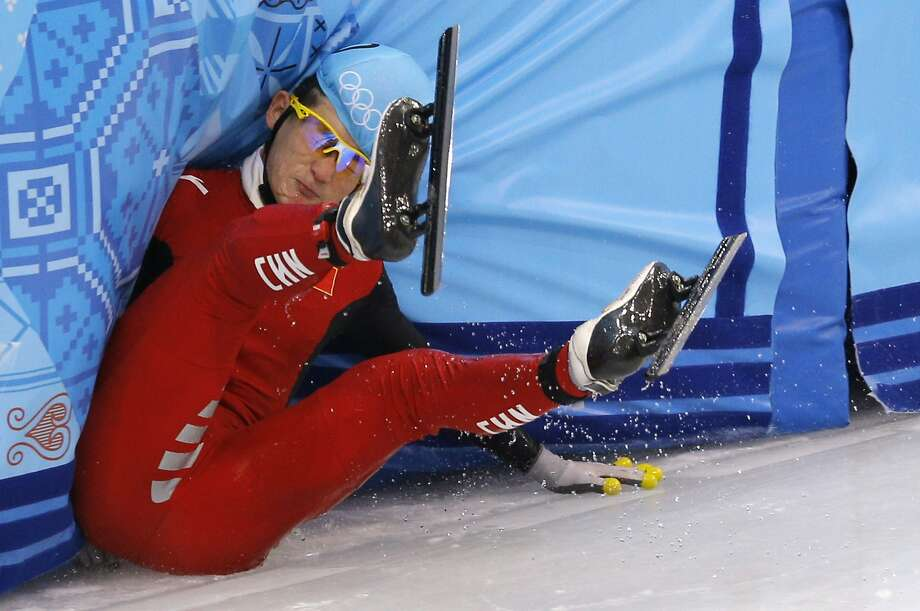 Liang Wenhao of China crashes out in the men's 500m short track speedskating final at the Iceberg Skating Palace during the 2014 Winter Olympics, Friday, Feb. 21, 2014, in Sochi, Russia.  Photo: Vadim Ghirda, Associated Press
