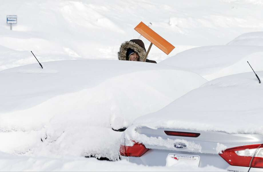 February white sale:Freeway Ford would like to sell you a new Focus or Fusion, if it could only find one. Sales consultant Debra Anderson does her best to dig out the inventory after a heavy snowfall in Bloomington, Minn. Photo: Jim Mone, Associated Press