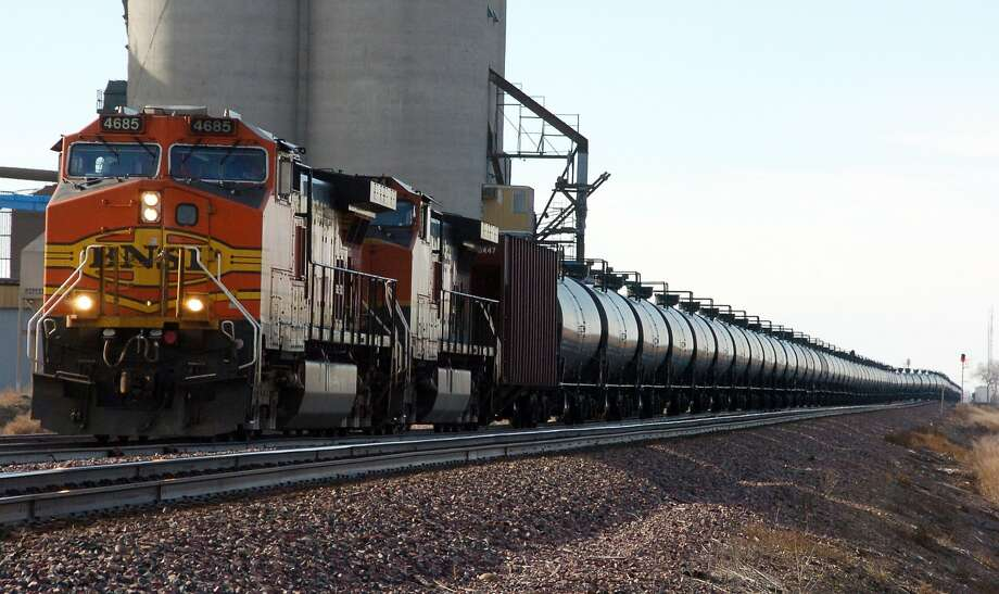 A BNSF Railway train, above, hauls crude oil near Wolf Point, Mont. Photo: Matthew Brown, Associated Press