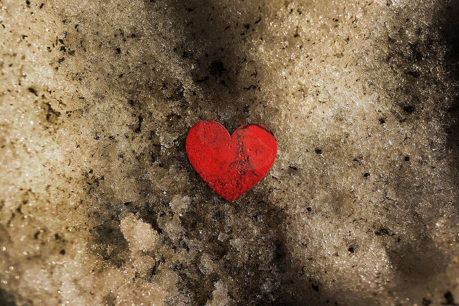 My forgotten valentine: A discarded paper heart sits on a mound of melting snow as temperatures rise in New York City. Photo: Spencer Platt, Getty Images